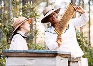 Queen Latifah and Dakota Fanning inspecting bees provided by Julian Wooten.